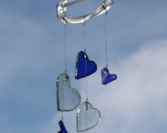blue and tinted clear glass heart valentine's day wind chime mobile from recycled bottles