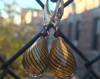 Light and lovely handblown caramel brown striped teardrop glass earrings.