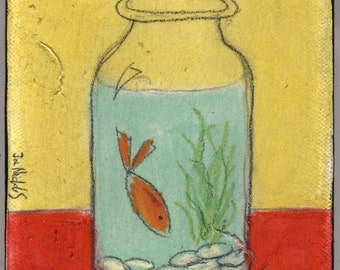 goldfish on red table