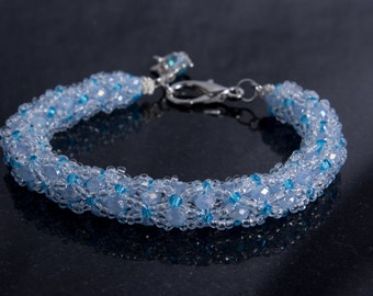 Ice Blue Czech Glass Netted Bead Bracelet with Dolphin Charm and Lobster Clasp, Ocean Theme Beaded Wrist Wrap
