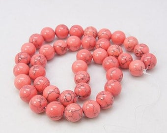 Magnesite Beads, Coral, 10mm Round - 15 inch Strand