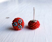 Handwoven Button Stud Earrings in glossy red with a turquoise-blue daisy folk-inspired pattern and sterling silver posts - Songbead UK