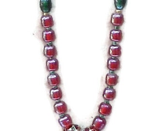 Red glass bead necklace with 1 inch rhinestone pendant