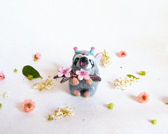 Sloth figurine. Adorable fairy sloth eating cherry blossom. One of a kind.