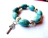 Gypsy/ Boho/ Southwest Stretch Bracelet - Chunky Turquoise Magnesite Barrels, Silver Plated Spacers, Key Charm Dangle - Beads