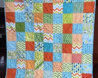 Scrappy quilt boy baby toddler modern patchwork quilt blanket bright colorful orange blue green white