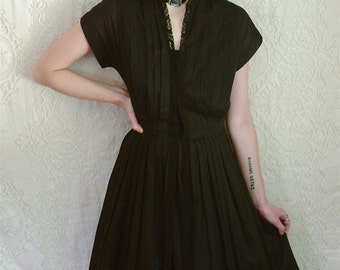 vintage 1950s black semi sheer pleated dress