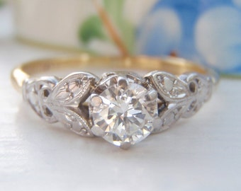 Classic Vintage Solitaire Diamond Engagement Ring. Quality 18K Yellow Gold and Platinum. Fabulous Ornate Leaf Patterned Shoulders. So Sweet!