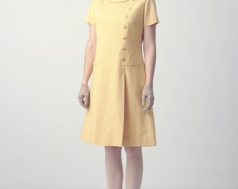 1960s harvest gold shift dress, quality vintage yellow asymmetric Jackie O inspired A-line dress, short sleeve, high collar, button front