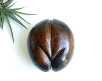 Sculpture, carved wood replicating Coco fesse / Coco de mer from Seychelles islands