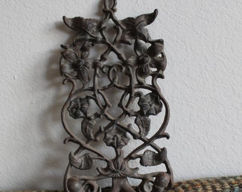 Vintage Cast Iron Double Wall Hooks Display