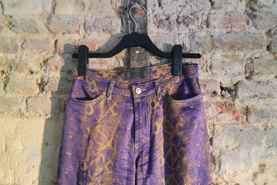 vintage Versace jeans trousers snake print glam rock medusa buttons