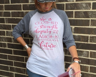 Free Shipping! She is clothed in Strength and Dignity Raglan Shirt/ Proverbs 31:25 shirt/ Christian Shirt/ Jesus Shirt/ Christianity/ God