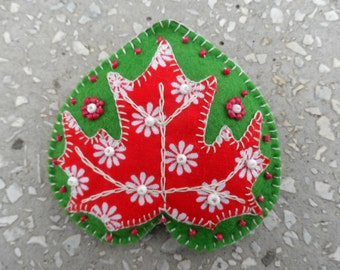 Brooch heart 'a maple leaf'. Green brooch with red maple leaf application