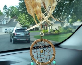 DREAM CATCHER for your rear view mirror!  BEAUTIFUL in browns with a touch of turquoise or black&white feathers. Free photo key chain, too!