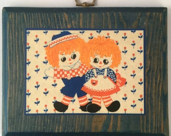 Vintage Raggedy Ann and Andy Wood Plaque Decor - Toy Rag Dolls, Red Blue Prints & Stripes, Flower Background, Orange Hair, Decoupage on Blue