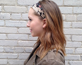 Silk wide Headband in Black with large floral print accents of cream green and peach