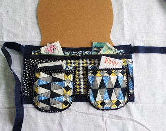Saleswoman's apron. Apron with thes large pockets and extra pockets.