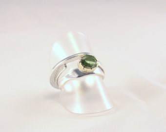 ring of silver and peridot in a 14kt gold settings