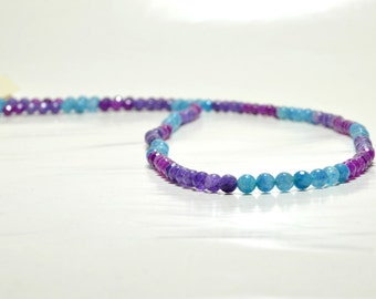 Long necklace with purple and blue beads .