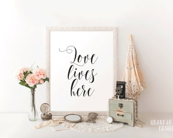 Printable art Love quote printable Love lives here Simple black and white quote print Master bedroom wall decor printable Typography print