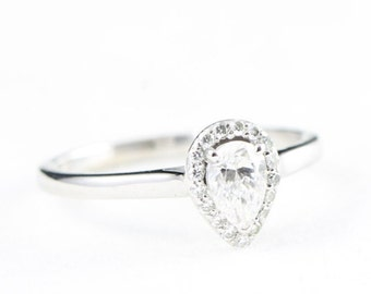 Pear diamond solitaire engagement ring in 9 carat gold for her