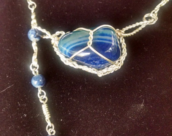 Featured listing image: Blue stone caged in hand twisted silver wire. One of a kind necklace.
