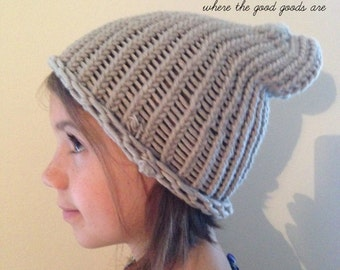 Gray slouchy hat. Made by kids. Probably best for kids. Or people with smallish heads