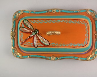 Dragonfly in field of Amber butter dish