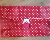Red and white polka-dot fabric clutch bag