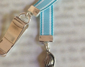 Sea Shell bookmark - Attach clip to book cover then mark the page with the ribbon. Never lose your bookmark!