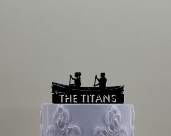 Canoeing Couple Cake Topper, Contains a Male and Female in a Canoeing.  Customized with Your Name or Phrase