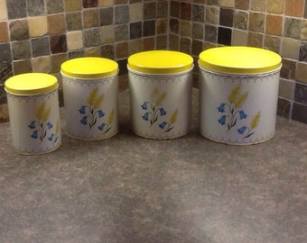 Set of four tin canister set bright yellow