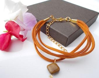 Tiger's eye bracelet , multi strand bracelet , suedette bracelet , gold plated jewelry , tiger's eye jewelry , brown jewelry , charm jewelry