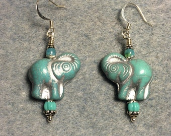 Turquoise and silver Czech glass elephant bead dangle earrings adorned with turquoise Czech glass beads.