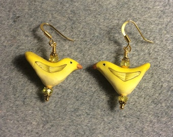 Yellow polymer clay bird bead earrings adorned with yellow Chinese crystal beads.