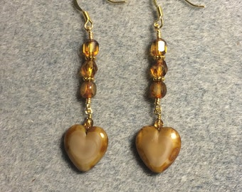Opaque caramel Czech glass heart bead dangle earrings adorned with caramel Czech glass beads.