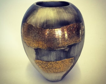 Ceramic pot,  smoke-fired porcelain with gold lustre.
