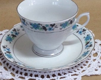 Vintage Tea Cup and Saucer, Cup and Saucer with Turquoise flowers & Silver trim.