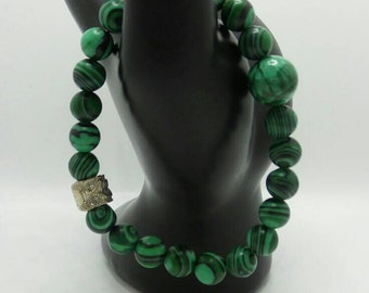 Malachite beaded stretch bracelet.