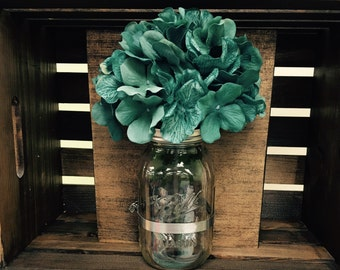 Manson jar wall sconce with hydrangea