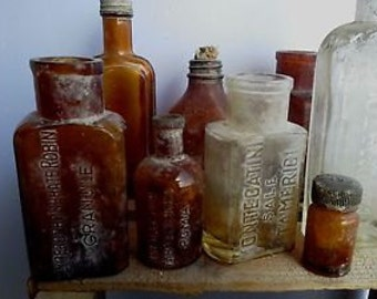 Ten bottles pharmaceutical antique