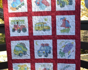 Cross stitch baby quilt featuring vehicles