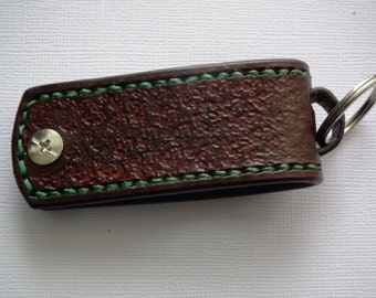 Brown leather key chain with green stitching