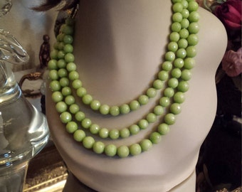 Three strand faceted round beaded lime green jade necklace