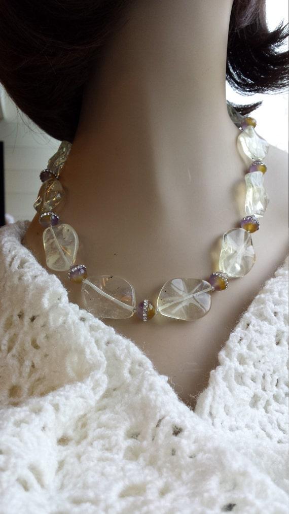 One strand polished flat opulite and inlaid crystal jasper