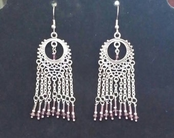 Silver chandelier earrings with purple crystals