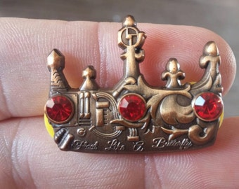 "The Disco Biscuits ""King of the World"" hat pin"