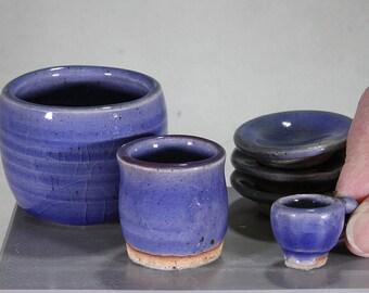 Set of miniature blue stoneware ceramic pots: Teacup, bowl, jar, and 3 plates.