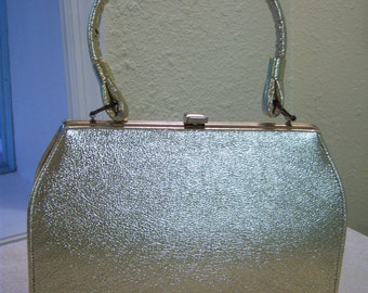 Gold metallic vinyl purse/Vintage gold purse/Black satin interior/Metal top closure/Dress purse/Mod purse/Vintage clothing